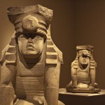 Two young Olmec rulers, twins, paying homage to a feline-jaguar deity